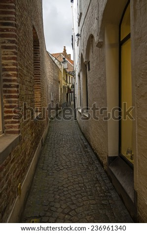 A small narrow street in Bruges, a popular tourist destination in Belgium.