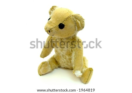 A small old worn teddy bear isolated on near white - stock photo