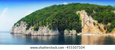 a small peninsula in the calm sea in warm summer day - stock photo