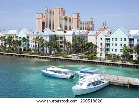 A small pier for water taxi on Paradise Island (The Bahamas). - stock photo