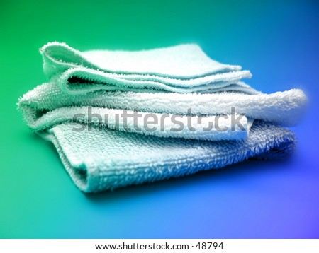 A small pile of facecloths on a bright background.