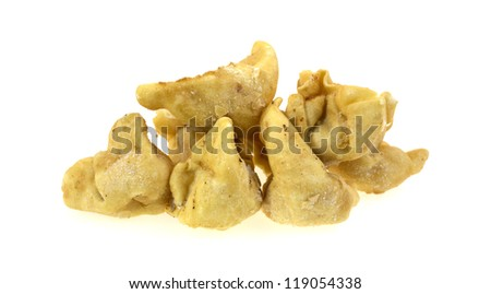 A small pile of frozen crab rangoons on a white background. - stock photo