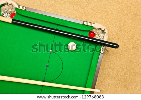 A Small Pool Table On The Floor