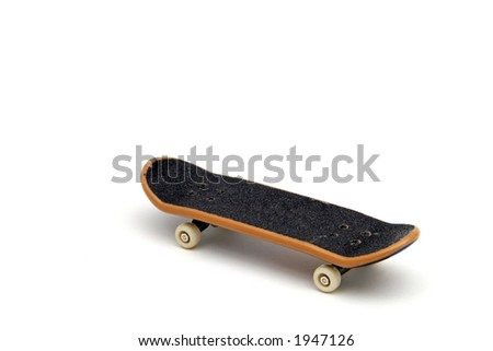 A small scale model toy skateboard.