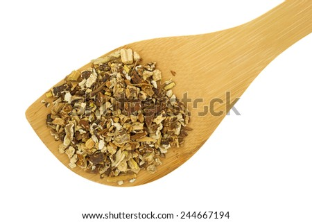 A small spoon filled with dried chopped dandelion root on a white background. - stock photo