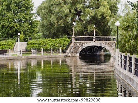 A small stone bridge on the Rideau canal in Ottawa, Canada during summer.