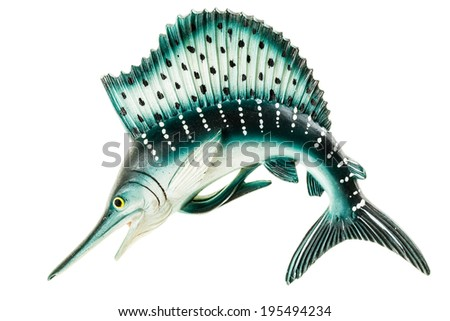a small swordfish fridge magnet made in plastic and isolated over white - stock photo