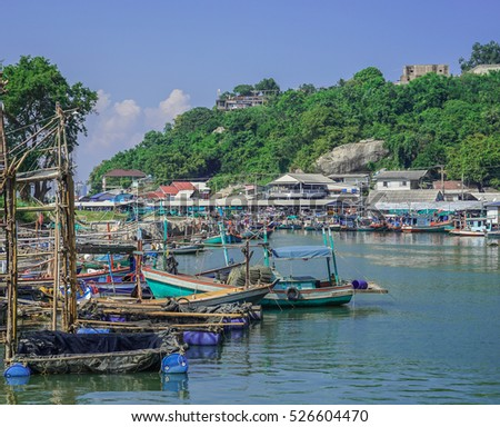 A small tranquil, colorful fishing harbor in Thailand.