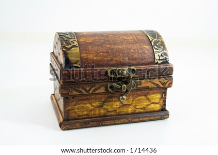 A small treasure chest, isolated on white - stock photo