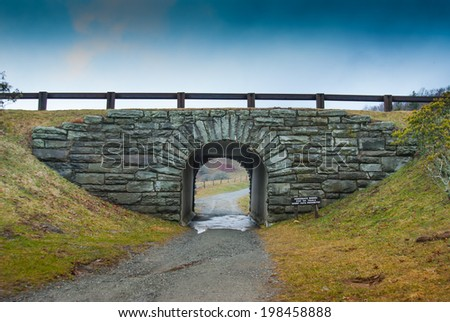 A small tunnel allows hikers and horseback riders to cross under the Blue Ridge Parkway - stock photo