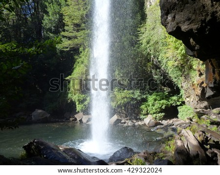 a small waterfall flowing of a basalt rock in a deep forest
