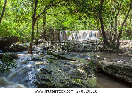 A small waterfall in a tropical forest, Thailand.