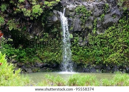 A small waterfall on 'Road to Hana' on the Hawaiian Island of Maui - stock photo