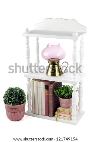 A small white bookcase and some books - stock photo