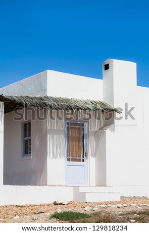 A small white house in the West-Coast. - stock photo