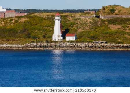 A small white lighthouse on the coast of Canada near Halifax - stock photo
