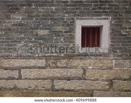 a small window on a brick wall