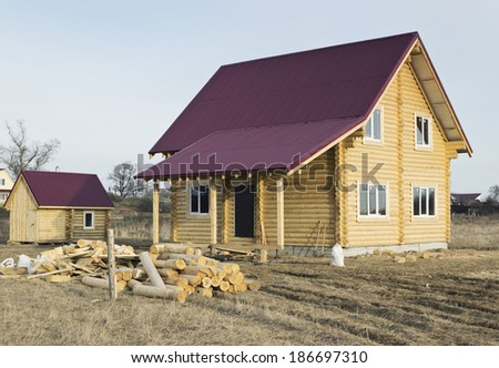 A small wooden house with iron roof