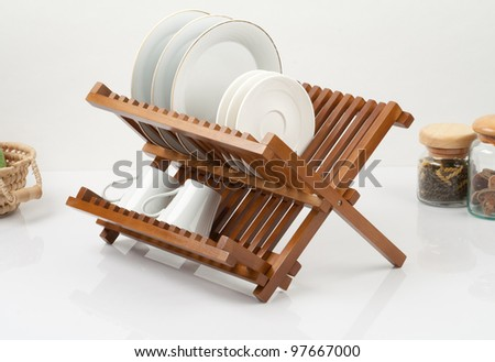 A small wooden shelf for keeping dishes and cups - stock photo