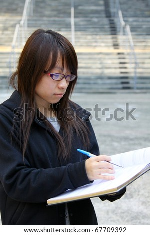 A smart Chinese girl reading in a University