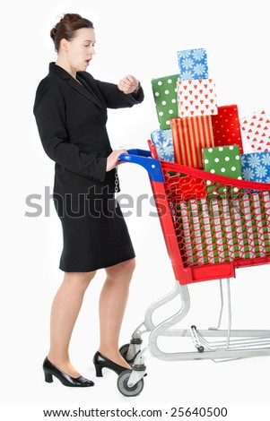 A smartly dressed woman shopping for gifts looking at her watch - late.