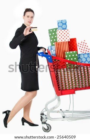 A smartly dressed woman shopping for gifts with a credit card on white - stock photo