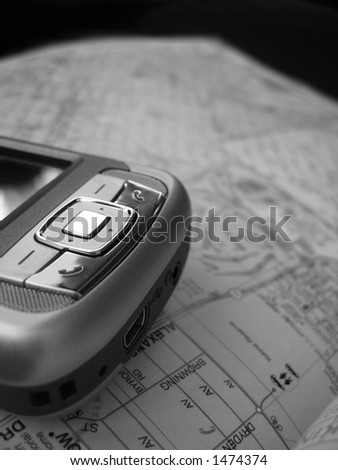 A Smartphone PDA with GPS capability. The background is a street map. This is a black and white image.