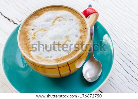A smile on the coffee. - stock photo