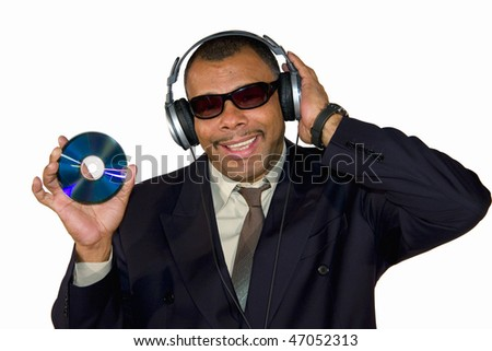 a smiling African-American mature man with sunglasses and headphones presenting an audio compact disk, isolated on white background