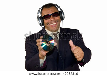 a smiling African-American mature man with sunglasses and headphones presenting an audio compact disk and posing with thumbs up, isolated on white background - stock photo