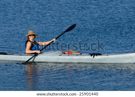 A smiling attractive young woman in sea kayak. Mission Bay, San Diego, California