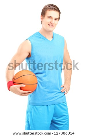 A smiling basketball player posing with a ball in his hand isolated on white background - stock photo