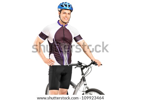 A smiling bicyclist posing next to a bicycle isolated against white background - stock photo