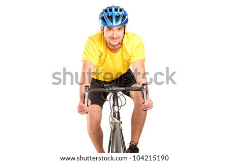A smiling bicyclist with yellow shirt posing on a bicycle isolated on white background - stock photo
