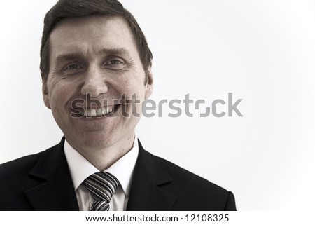 A smiling business man landscape orientation with copy space to the right. - stock photo