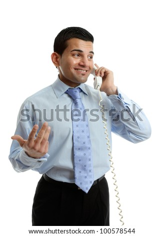 A smiling businessman in discussion conversation on the telephone.  White background. - stock photo