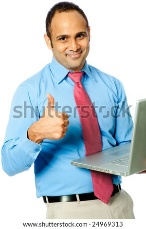 A smiling businessman with a laptop computer gives a thumbs-up. Isolated on white background.