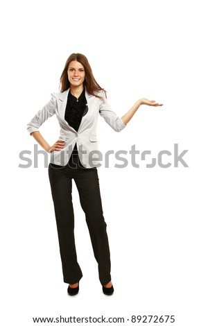 A smiling businesswoman displaying something with her hand, isolated on white background - stock photo