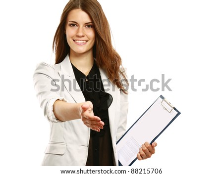 A smiling businesswoman offering a handshake, isolated on white