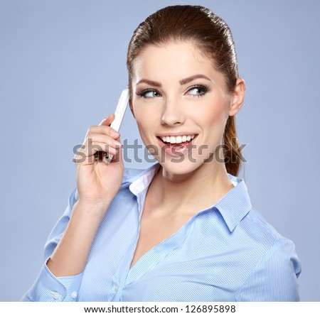 A smiling businesswoman talking on phone - stock photo
