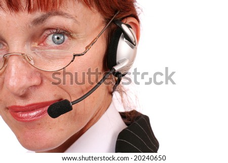 A smiling businesswoman wearing earphones over white background