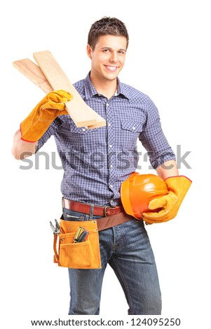 A smiling carpenter holding a helmet and sills isolated against white background