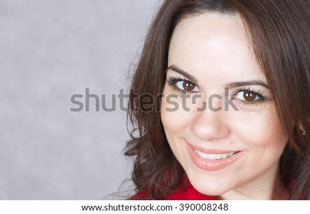 A smiling charming young woman between 30 and 40 years old. - stock photo