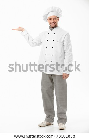 A smiling cook shows his hand on a white background