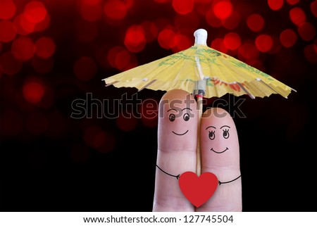 A smiling couple in love under the umbrella, valentines day - stock photo