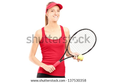 A smiling female holding a tennis racket and a ball isolated on white background - stock photo