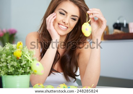 a smiling female laughing with colorful easter eggs - stock photo
