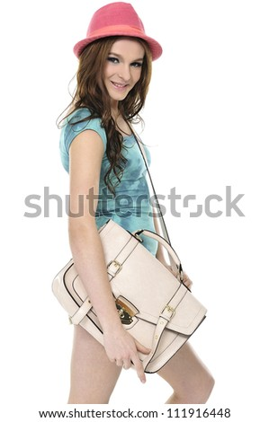 A smiling female student with bag isolated on white background