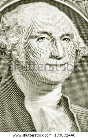 A smiling George Washington on a one dollar bill, close-up