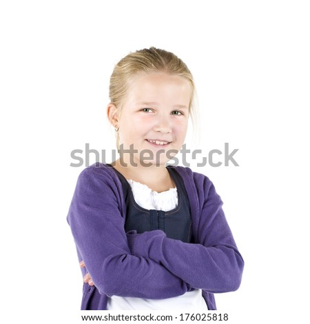 A smiling girl in a purple cardigan with her arms crossed.